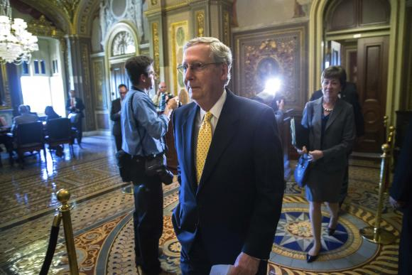 McConnell walks to speak to reporters after the weekly Republican party caucus luncheon at the U.S. Capitol in Washington